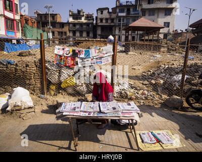 Kathmandu, Central Development Region, Nepal. 5th Mar, 2017. A woman sells Nepali newspaper in front of Kasthamandap, - Stock Photo
