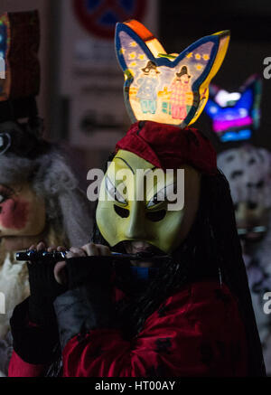 Basel, Switzerland. 6th Mar, 2017. Fools parade through the narrow streets of Basel, Switzerland, 6 March 2017. - Stock Photo