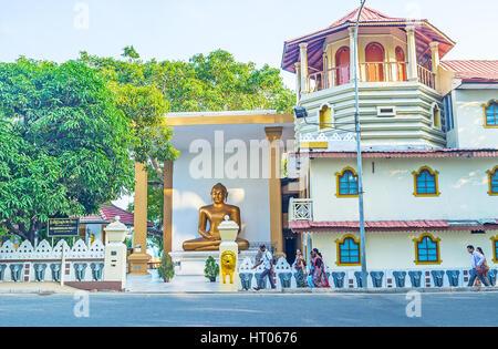 COLOMBO, SRI LANKA - DECEMBER 6, 2016: The golden Lord Buddha statue in Sri Sambuddhaloka Viharaya Temple, located - Stock Photo