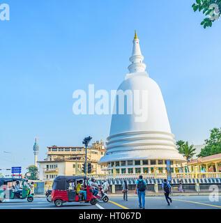 COLOMBO, SRI LANKA - DECEMBER 6, 2016: The way across the Lotus Road to the Sri Sambuddhaloka Viharaya Temple, on - Stock Photo