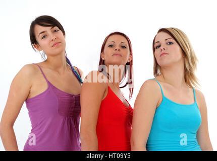 Drei junge Frauen in bunten Shirts - three young women in coloured shirts - Stock Photo