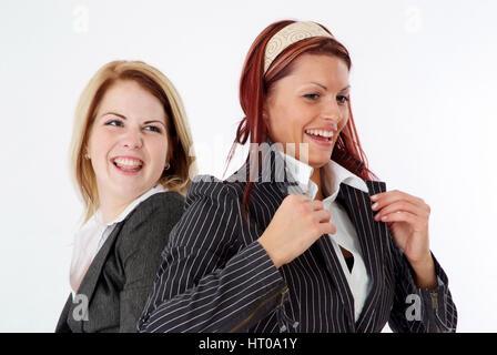 humorvolle Geschoeaeftsfrauen - humorous business women - Stock Photo