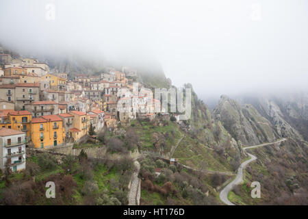 Castelmezzano (Potenza, Italy) - A view of the beautiful little town in the fog - Stock Photo
