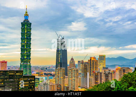 TAIPEI, TAIWAN - NOVEMBER 18: View of Taipei financial district architecture and Taipei 101 building in the evening - Stock Photo