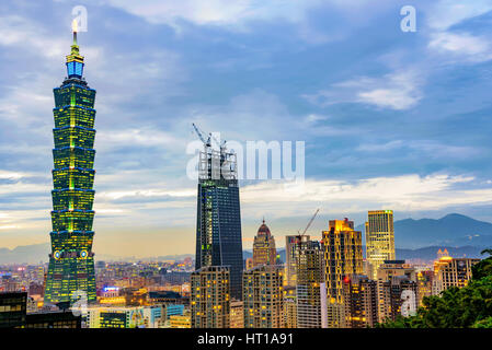 TAIPEI, TAIWAN - NOVEMBER 18: Evening view of Taipei financial district architecture and 101 building in the evening - Stock Photo