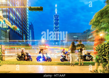 TAIPEI, TAIWAN - NOVEMBER 19: This is a street view of downtown Xinyi district and Taipei 101 building at night - Stock Photo