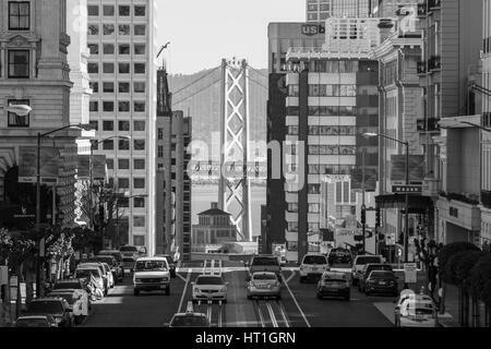 San Francisco, California, USA - January 14, 2013:  Black and white view of California Street with Bay Bridge background. - Stock Photo
