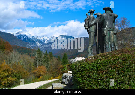 Statue dedicated to the first four men  who climb the Triglav mountain next the Church of St. John the Baptist at - Stock Photo