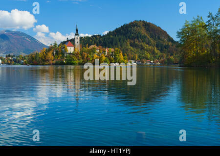 View of the castle and of the Church of the Assumption in the island of the Lake of Bled (Blejsko jezero), Slovenia - Stock Photo
