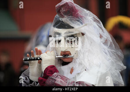 Basel, Switzerland. 6th Mar, 2017. A reveller participates in the carnival procession during the Carnival of Basel - Stock Photo