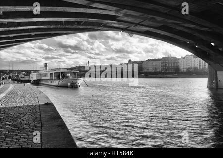 Prague,Czech Republic - March 3,2017: View on the Vysehrad boat under the bridge after rain.Vyšehrad is one of the - Stock Photo