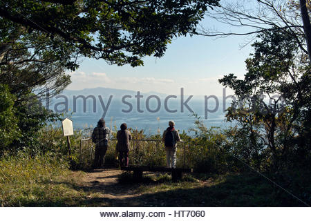 people looking out over a seascape Japan Tokyo Bay - Stock Photo