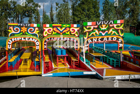 Colourful Mexican boats with women names at Xochimilco's Floating Gardens - Mexico City, Mexico - Stock Photo