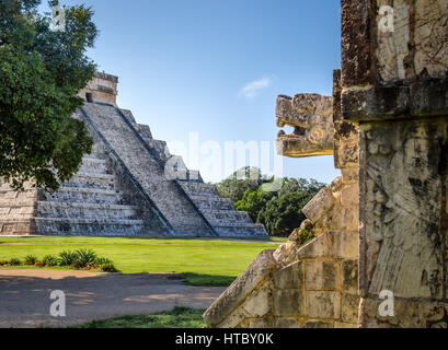Jaguar head and Mayan Temple pyramid  of Kukulkan - Chichen Itza, Yucatan, Mexico - Stock Photo