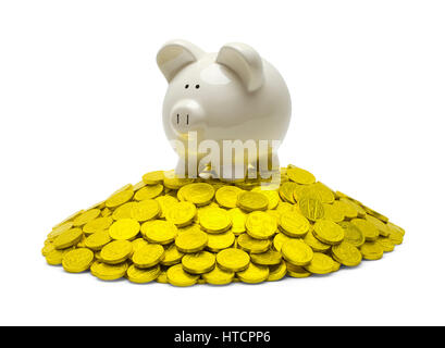 Piggy Bank on Top of Pile of Gold Coins Isolated on White. - Stock Photo