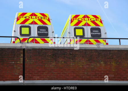 parked police emergency service vehicle in rooftop carpark lincoln - Stock Photo