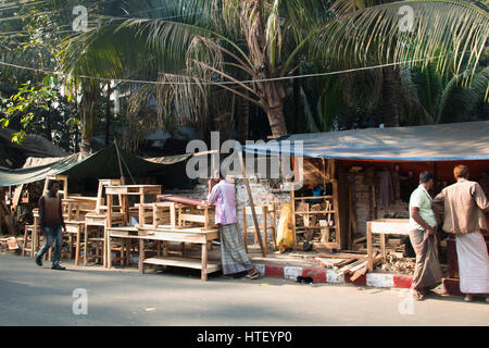 CHITTAGONG, BANGLADESH - FEBRUARY 2017: Men selling furniture from a stand on the street in Chittagong, Bangladesh - Stock Photo