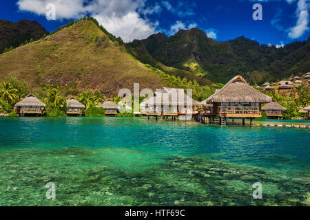 Tropical resort with over water bungalows on Moorea Island, French Polynesia - Stock Photo