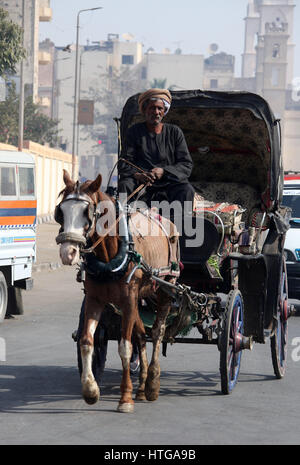 Kalesh on the streets of Luxor in Egypt - Stock Photo