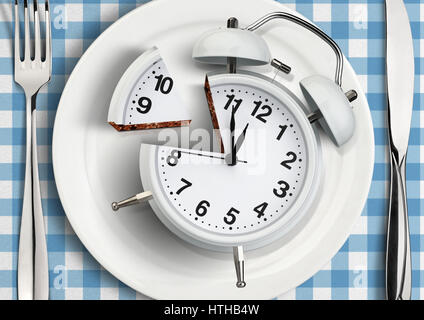 Time to meal concept, cut clock on plate. - Stock Photo
