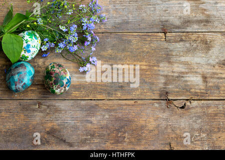 Decoupage decorated Easter eggs on rustic wooden background, top view - Stock Photo