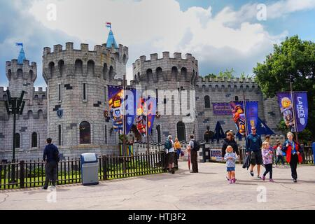 LEGOLAND, WINDSOR, UK - APRIL 30, 2016: Visitors outside the Nexo Knights castle at Legoland - Stock Photo