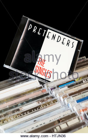 The Singles, 1987 Pretenders CD pulled out from among rows of other CD's, England - Stock Photo
