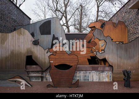 Creative outdoor playground made of artistically designed wood in the form of animals. Leipzig Zoological Garden, - Stock Photo