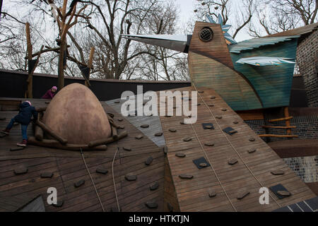 Children climbing on a wooden outdoor playground in the Leipzig Zoological Garden, Leipzig, Saxony, Germany. - Stock Photo