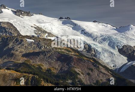 Telephoto of Sphinx Glacier and Bookworms in Coast Mountains of British Columbia, Canada from Panorama Ridge above - Stock Photo