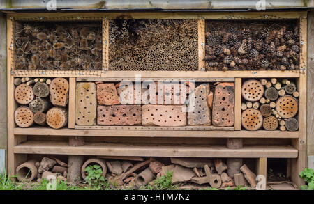 A Wildlife Stack made to provide places or refuges for wild creatures to live in the dead and decaying wood materials - Stock Photo