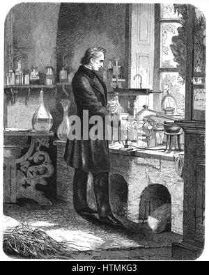 Justus von Liebig (1803-1873) German chemist, at work in his laboratory. Engraving from 'The Popular Educator', - Stock Photo
