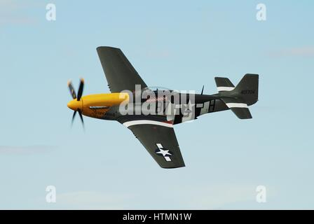 Mustang P-51D fighter plane Ferocious Frankie displays at the Dunsfold airshow in Surrey, England. The Second World - Stock Photo