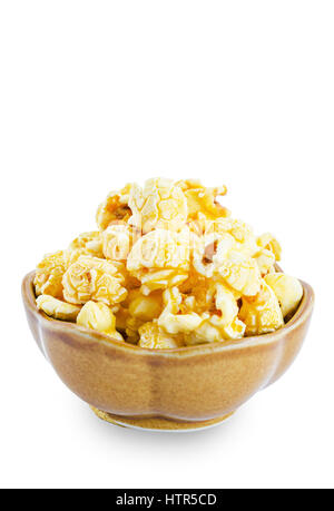 Sweet caramel popcorn in a bowl isolated on white background, Save clipping path. - Stock Photo