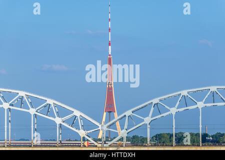 Railway Bridge over Daugava River (Western Dvina) in Riga, capital city of Latvia. View from Stone Bridge with Radio - Stock Photo