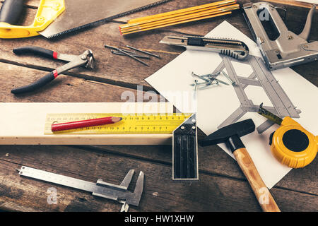 carpenter diy tools on old wooden table in workshop - Stock Photo