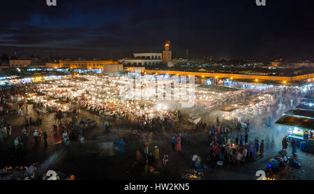 Famous square Jemaa El Fna busy with many people and lights during the night, medina of Marrakesh, Morocco - Stock Photo