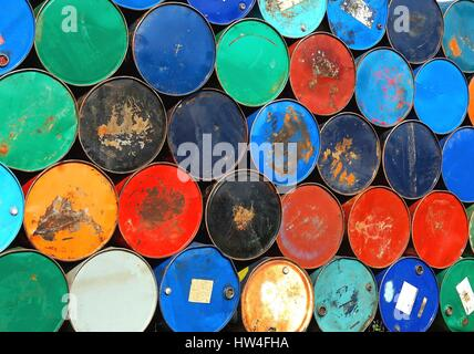 Multicolors old rusty oil barrels stack in rows - Stock Photo