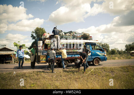 Bus pictured somewhere in Si Phan Don, Laos. - Stock Photo