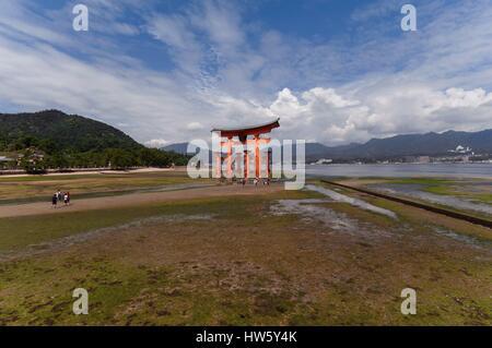 Japan, Hiroshima Prefecture, Miyajima Island (Itsukushima), famous torii at low tide, listed as World Heritage Site - Stock Photo