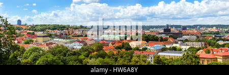 Panorama of Vilnius from top of mountain of Gediminas Tower. Red rooftops of old town & modern business building - Stock Photo