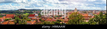 Panorama of Vilnius from top of mountain of Gediminas Tower. View of red rooftops of old town, spires and towers - Stock Photo