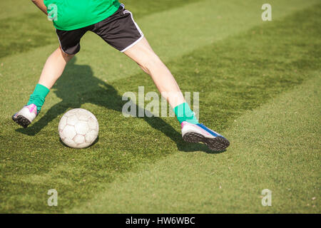 Feet of players in soccer with a ball close-up. - Stock Photo