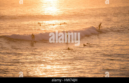 Surfers catching a wave in Huntington Beach, California.  Surf City USA. - Stock Photo