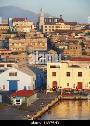 Dock of port of Santiago de Cuba with Iglesias Catedral at top. - Stock Photo
