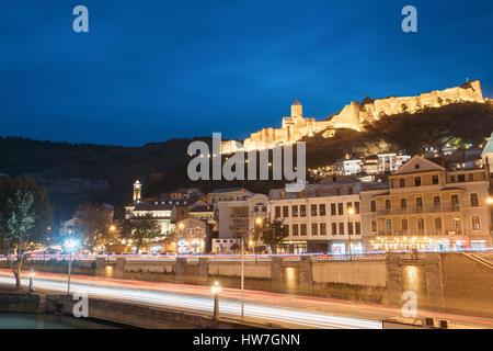 Tbilisi, Georgia - October 21, 2016: Narikala Ancient Fortress In Evening Night Illumination Under Blue Sky. - Stock Photo