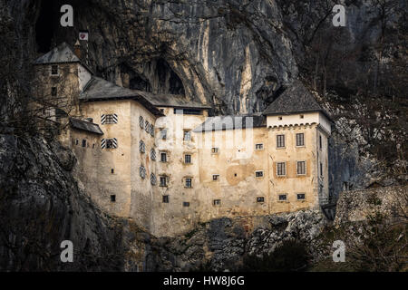 Predjama Castle is a Renaissance castle built within a cave mouth in south-central Slovenia, in the historical region - Stock Photo