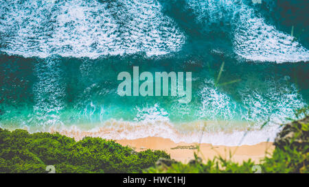 Aerial view of Waves on Nunggalan Beach on Sunny Day, near Uluwatu, Bali, Indonesia - Stock Photo