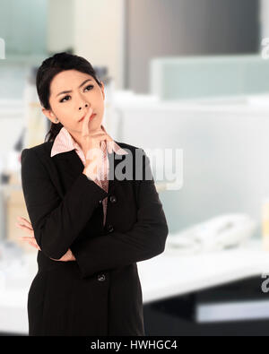 Asian business woman thinking seriously on the office - Stock Photo