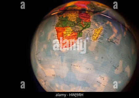close up of old fashioned world globe a ball shaped map lit from within focusing on South Africa - Stock Photo
